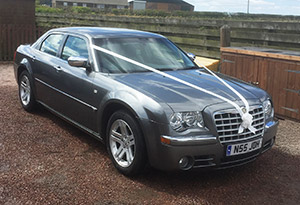 chrysler 330d with wedding ribbons